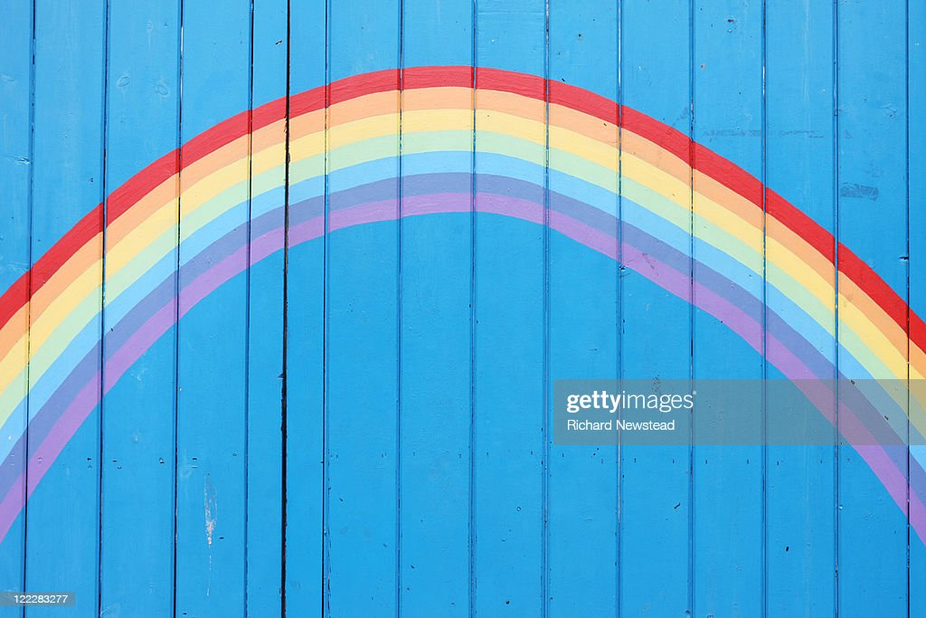 Painted rainbow on wooden fence : Stock Photo