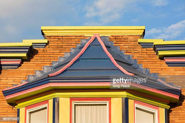 Painted row house pediment and bay window