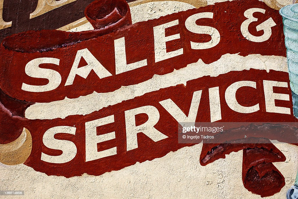 painted sign on an old building : Stock Photo