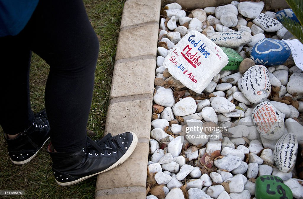 Painted stones with messages are seen after being placed outside former South African President Nelson Mandela's residence in Johannesburg by well-wishers on June 25, 2013. Mandela's close family gathered today at his rural homestead to discuss the failing health of the South African anti-apartheid icon who was fighting for his life in hospital. Messages of support poured in from around the world for the Nobel Peace Prize winner, who spent 27 years behind bars for his struggle under white minority rule and went on to become South Africa's first black president.