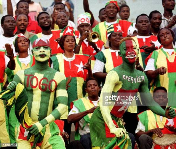 Painted supporters of Togo's national team sing and dance during the African Nations Cup group A match Cameroon vs Togo 31 January 2000 in Kumasi...