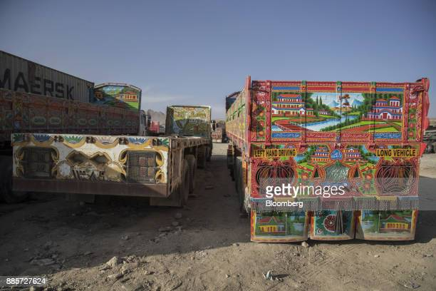 Painted transfer trucks sit at a yard in Kabul Afghanistan on Saturday Nov 4 2017 The Afghan economy is said to grow 26% in 2017 and revenue...
