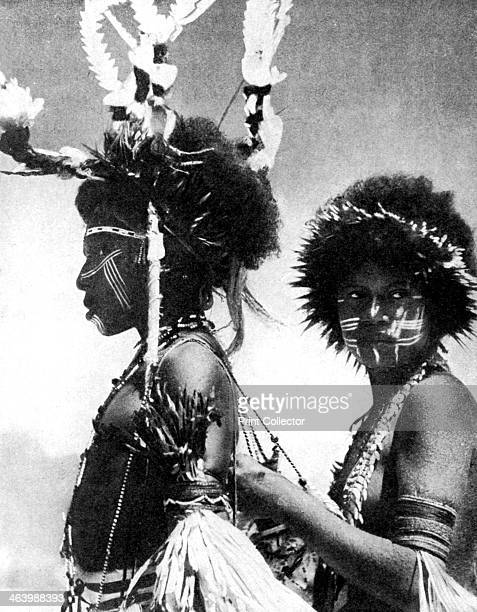 Painted warriors Papua New Guinea 1936 From Peoples of the World in Pictures edited by Harold Wheeler published by Odhams Press Ltd
