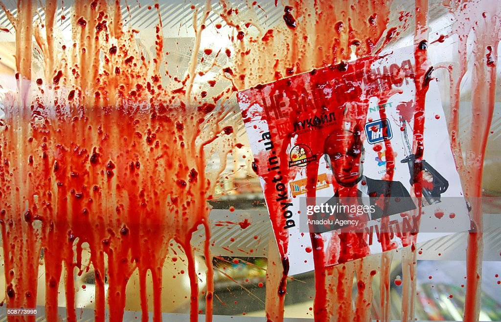 Painted window of a gas station owned by Russians is seen during Ukrainian Nationalist organization Right sector's protest against 'Russian business in Ukraine' in Kiev, Ukraine on February 06, 2016.