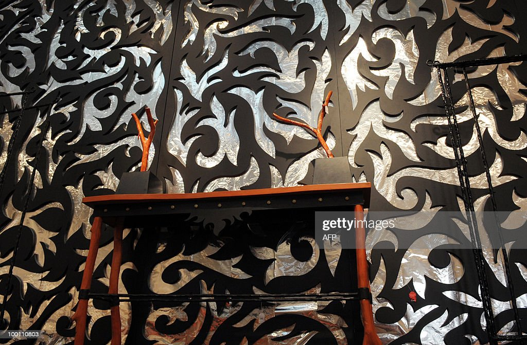 Painted wood pannels, console and wood accessories hangers designed by Elizabeth Garouste and Mattia Bonetti for French fashion house Christian Lacroix are among about 100 lots exhibited at the auction house Sotheby's France in Paris on May 21, 2010 before a sale on May 26, 2010 organised at the initiative of Christian Lacroix Company. In 1987 Christian Lacroix hired furniture designers Garouste and Bonetti to create the complete bespoke interior of his fashion house located on the Parisian Faubourg Saint Honore. Apart from the salons, the team also designed the packaging, the writing paper, the logo.