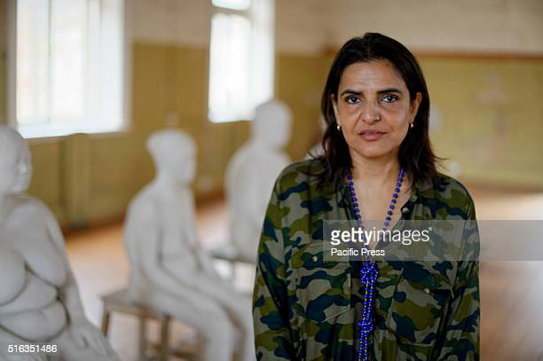 Painter and sculptor Bharti Kher poses with her works in the Convict Precinct during the media preview for Biennale of Sydney The 20th Biennale of...