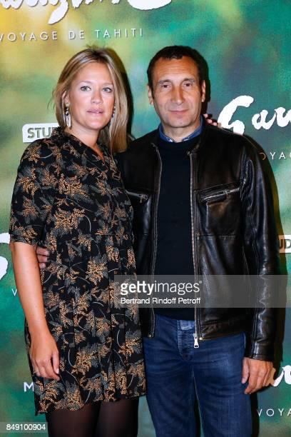 Painter Caroline Faindt and her companion actor Zinedine Soualem attend the 'Gauguin Voyage de Tahiti' Paris Premiere at Cinema Gaumont Capucine on...