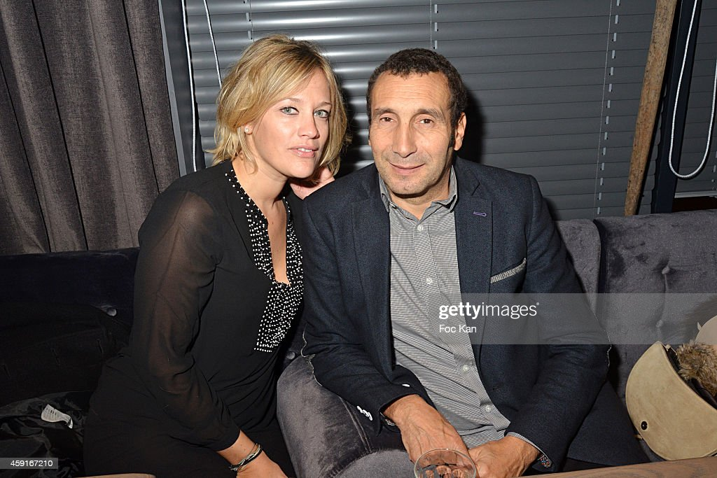 Painter Caroline Faindt and Zinedine Soualem attend Saperlipopette' : Norbert Cremaillere Party on November 17, 2014 in Puteaux, France.
