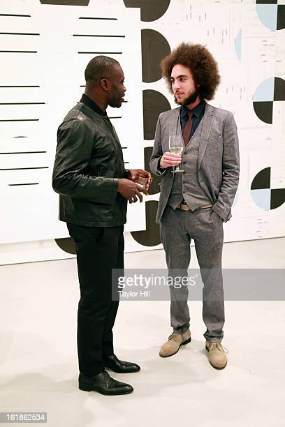 Painter Chris Ofili and Moses Mawila attend the Michael Riedel Art Exhibition Powerpoint at David Zwirner Gallery on February 16 2013 in New York...