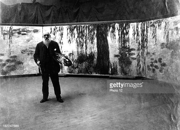 Painter Claude Monet in front of his 'Waterlilies' paintings Private collection