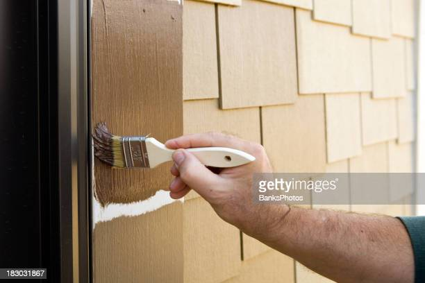 Painter Cutting in Door Trim with a Brush
