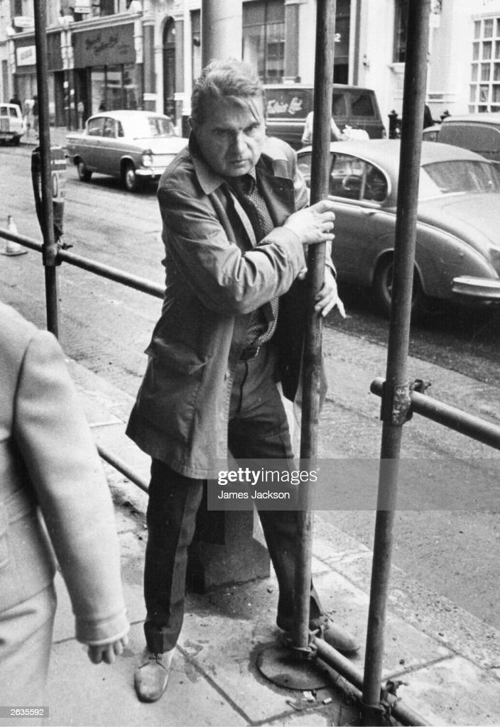 Painter Francis Bacon (1909 - 1992), in a London street.