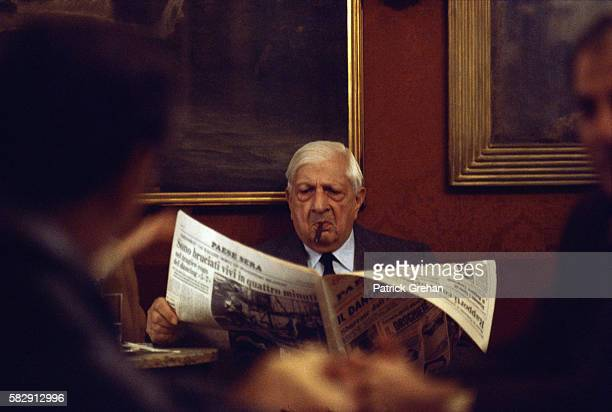 Painter Giorgio de Chirico Reading a Newspaper