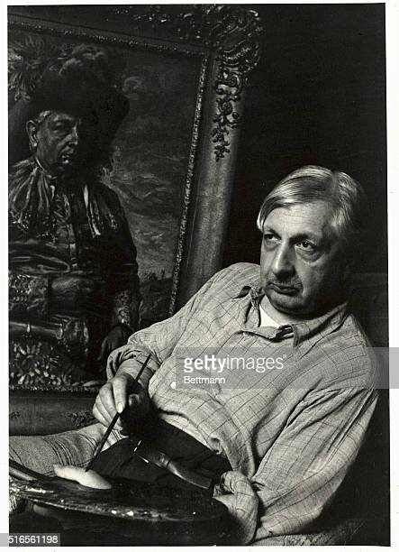 Painter Giorgio De Chirico with palette and painting in his studio in Rome Portrait undated photo