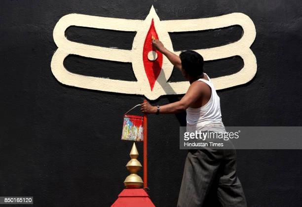 A painter giving final touches to the Shiv Linga for the forthcoming Mahashivratri festival at Jangaleshwr Temple Ghatkopar