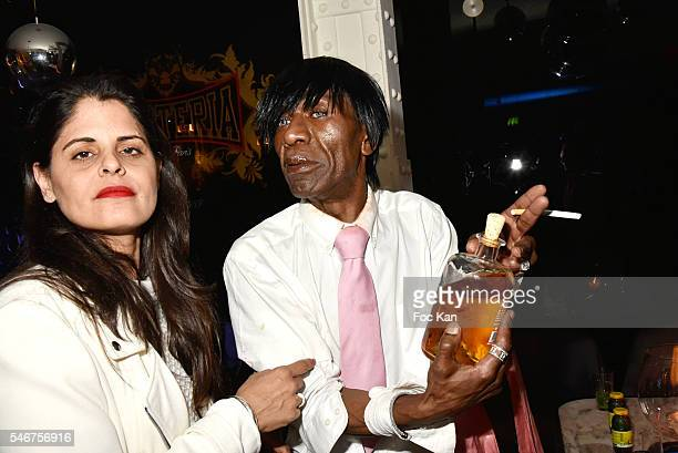 Painter Lee Michel and Dexter Dex Tao attend the Dexter Dex Tao Birthday Party at the Xu Sushis bar on July 12 2016 in Paris France