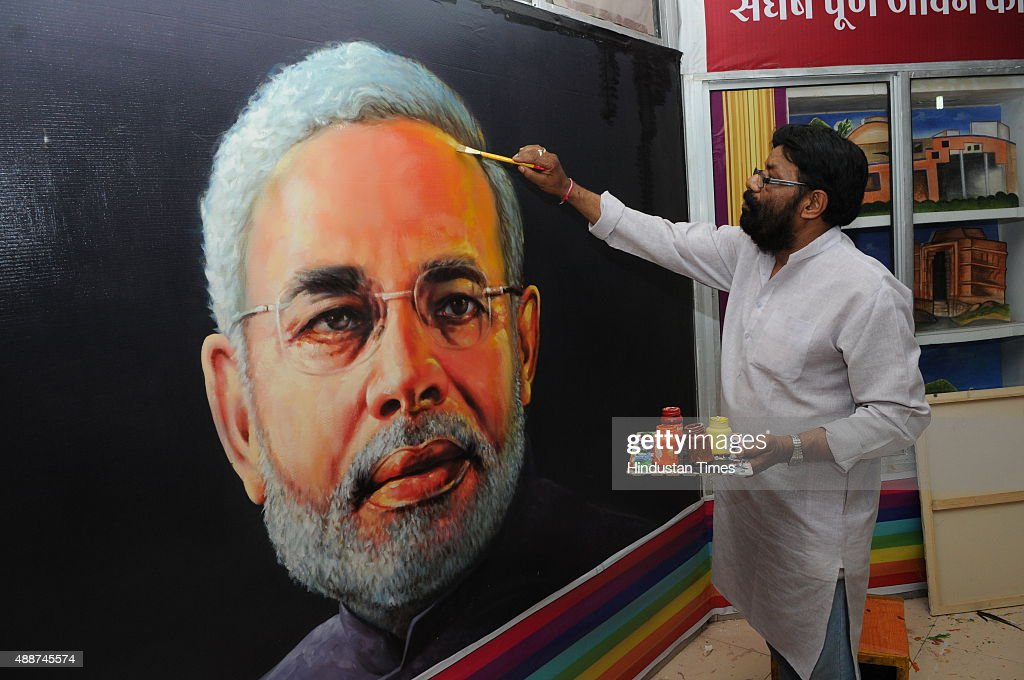Painter Raj Saini showing the paintings of Prime Minister Narendra Modi on the occasion of his 65th birthday on September 17, 2015 in Bhopal, India. - painter-raj-saini-showing-the-paintings-of-prime-minister-narendra-picture-id488745574