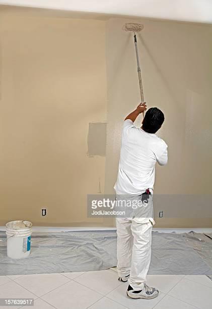 painter rolling paint