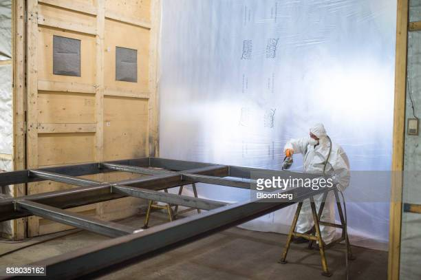 A painter sprays the bottom framework for a modular farming unit at the Modular Farms Co manufacturing facility in Cornwall Ontario Canada on Friday...