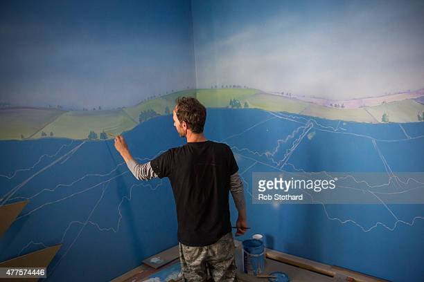 A painter works on a mural at Dreamland amusement park on June 18 2015 in Margate England Dreamland is considered to be the oldestsurviving amusement...