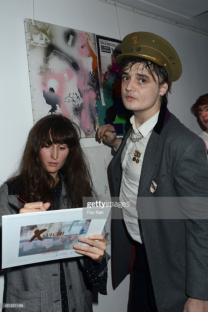 Painters Alize Meurisse and <a gi-track='captionPersonalityLinkClicked' href=/galleries/search?phrase=Pete+Doherty&family=editorial&specificpeople=203256 ng-click='$event.stopPropagation()'>Pete Doherty</a> attend the 'Flags From The Old Regime' : <a gi-track='captionPersonalityLinkClicked' href=/galleries/search?phrase=Pete+Doherty&family=editorial&specificpeople=203256 ng-click='$event.stopPropagation()'>Pete Doherty</a> and Alize Meurisse Paintings Exhibition Preview At Espace Djam on November 21, 2013 in Paris, France.