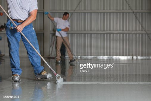 Painters Apply Epoxy Paint to an Airport Hanger