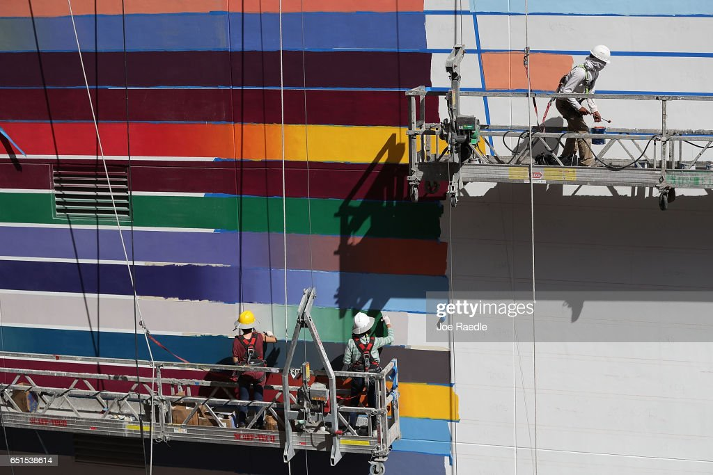 Painters are seen at work on a newly constructed building as the Bureau of Labor Statistics reports that nonfarm payrolls increased by 235,000 in February and the unemployment rate was 4.7 percent in the first full month of President Donald Trump's term on March 10, 2017 in Miami, Florida.