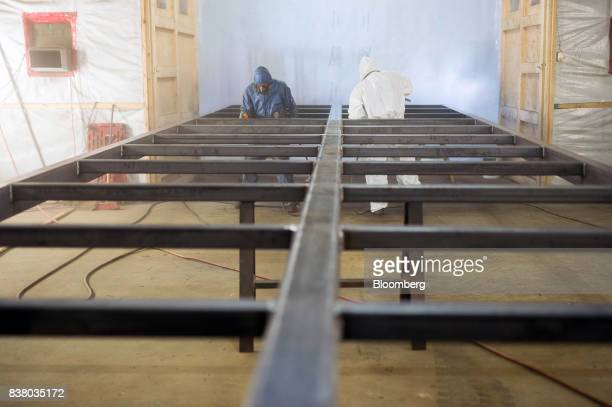 Painters finish the bottom framework for a modular farming unit at the Modular Farms Co manufacturing facility in Cornwall Ontario Canada on Friday...