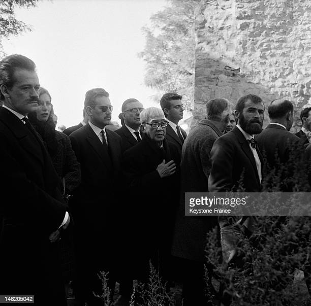 Painters Georges Mathieu and Foujita attend the funeral of painter and poet Jean Cocteau on October 16 1963 in Milly La Foret France