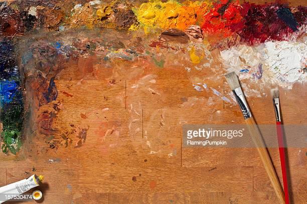 Maler Farbpalette und Pinsel. Full Frame, horizontale.