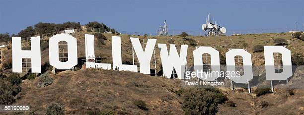 Painters with Bay Cal Commercial Painting work on the first 'L' as the news media observes the repainting of the iconic Hollywood Sign November 16...