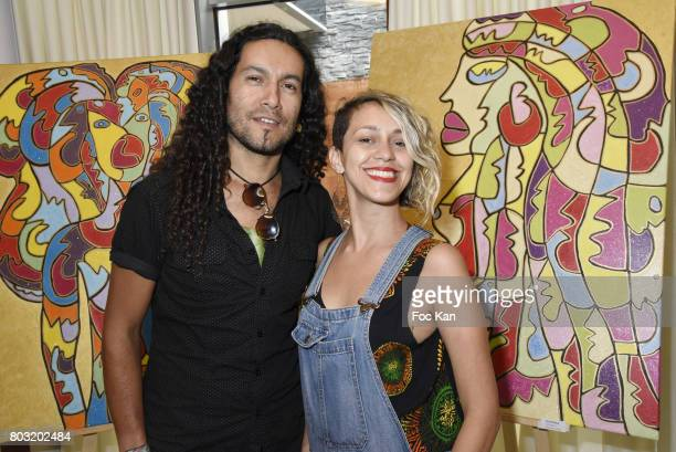 Painter/sculpor Sebastian Cifuentes Vargas and actress Jenne Jaratus attend the Dimensions Lee Michel Exhibition Preview at Hotel Rennaissance on...