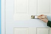 Painting a door, close up