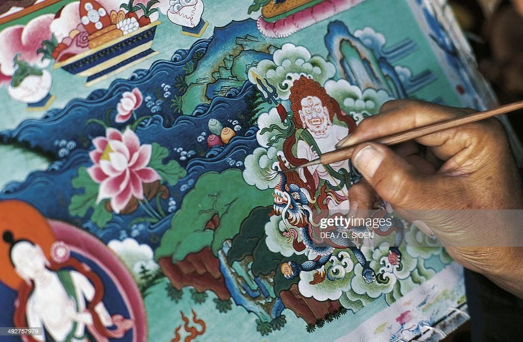 Painting a thangka or tangka (painted or embroidered Buddhist banner), Lhasa, Tibet, China.