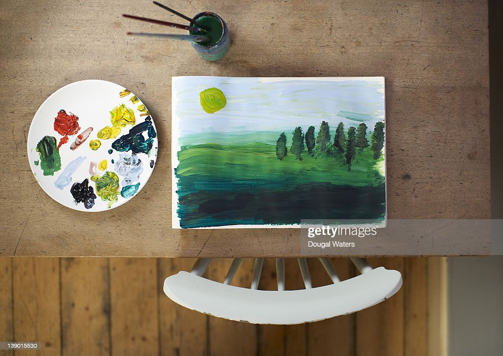 Painting and artist materials on table. : Stock Photo