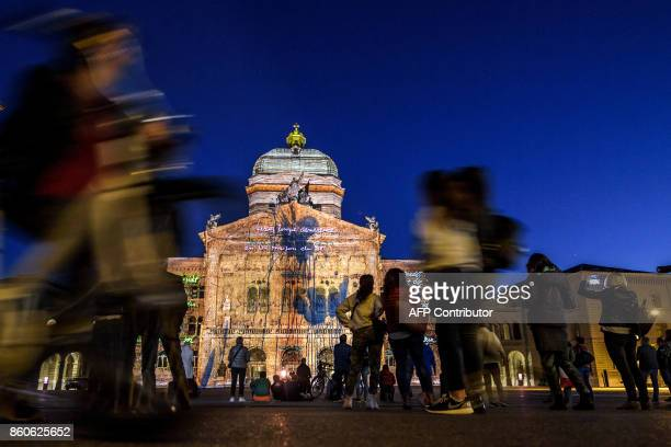 Painting are projected onto the Swiss House of Parliament during a light show entitled 'Rendezvous Bundesplatz' on October 12 2017 at Swiss capital...
