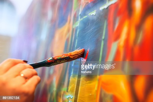 painting brush on wall : Foto de stock