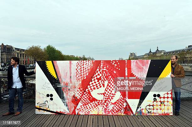 A painting by artists Dag and Russian Artof Popof is presented on the Pont des Arts bridge on April 5 2011 in the center of Paris as part of...