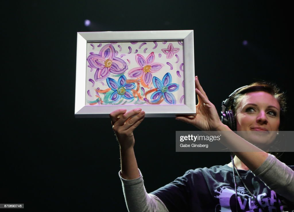 10,000 - US dollar amount won at auction by Britney Spears' original painting at the Vegas Cares benefit. It was purchased by onetime tv host (and Vegas Cares auctioneer) Robin Leach.