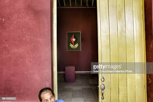 A painting depicting late Cuban Revolution leader Fidel Castro's insignias as Comandante en Jefe in a gallery on occasion of the first anniversary of...