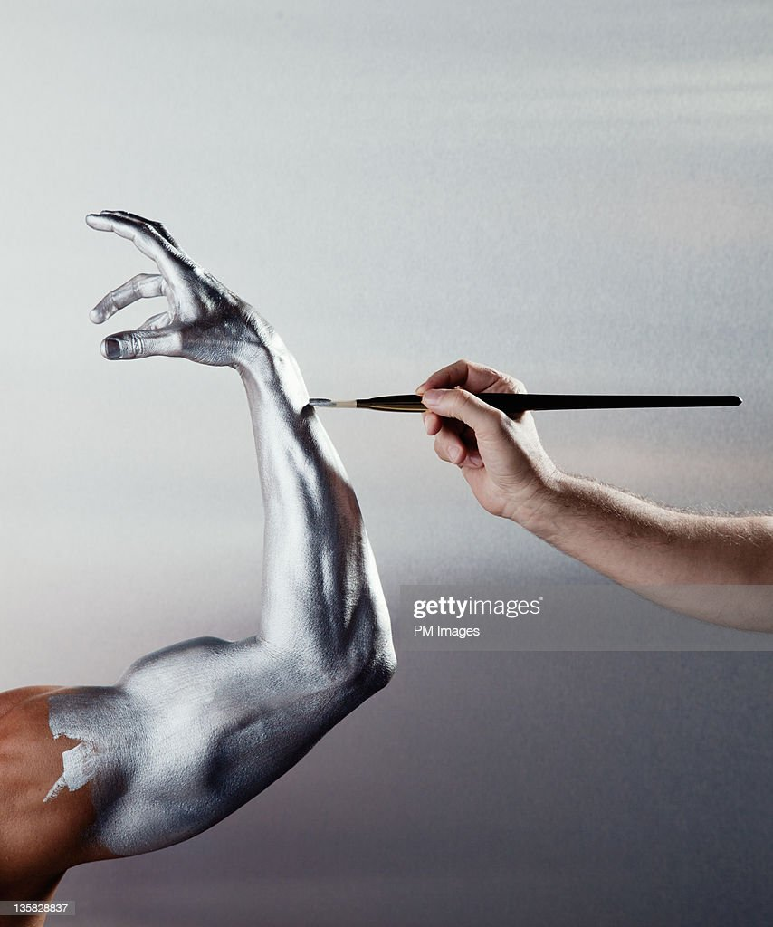 Painting man's arm silver : Stock Photo