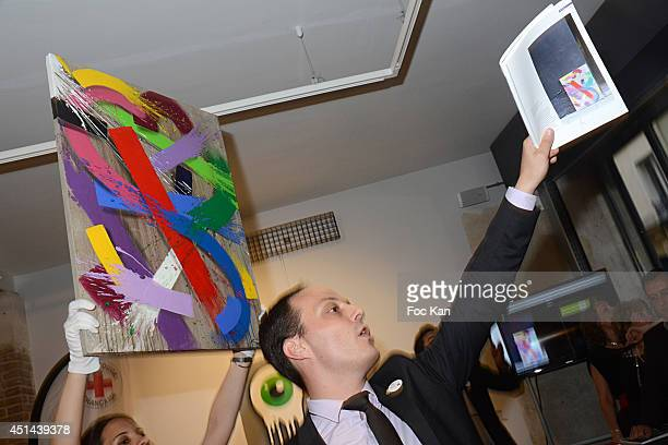 A painting of artist 'Babs UV TPK' is exhibited and sold during the 'Croix Rouge Francaise' 150 th Anniversary Auction Cocktail hosted by Jean...