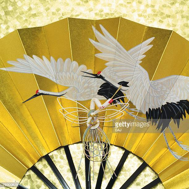 Painting of cranes on Japanese folding fan, front view, close up