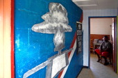 A painting of mushroom cloud drawn by an American teacher with a message 'Everything is in God's Hands' is seen at an elementary school on January 12...