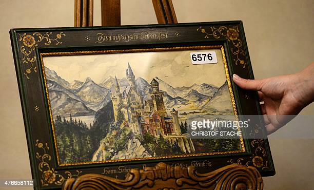 A painting of Neuschwanstein Castle a watercolor signed A Hitler is displayed on June 11 2015 in the Weidler auction house in Nuremberg southern...