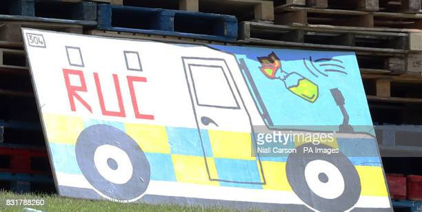 A painting of police Landrover and a petrol bomb on a bonfire in the bogside area of Londonderry which is traditionally torched on August 15 to mark...