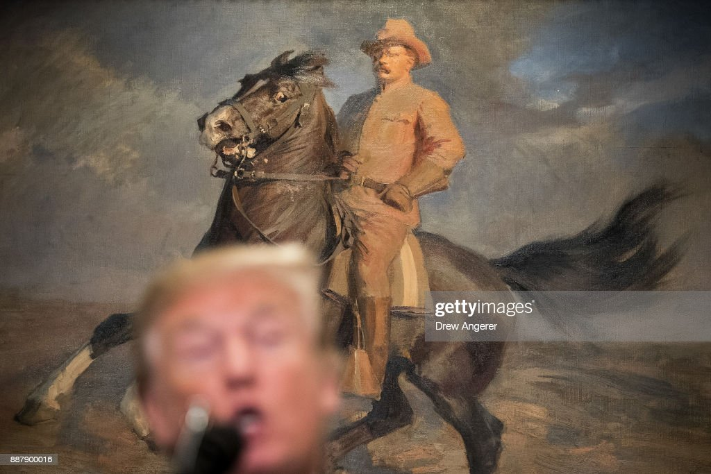 A painting of Teddy Roosevelt hangs behind President Donald Trump as he speaks before signing a proclamation for National Pearl Harbor Remembrance Day, in the Roosevelt Room of the White House, December 7, 2017 in Washington, DC. Thursday is the 76th anniversary of the attacks against the Hawaii naval base.