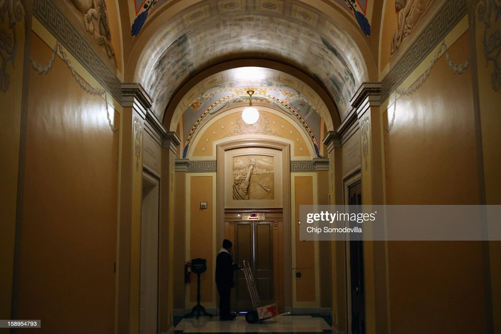 A painting of the Statue of Liberty and New York Harbor adorns the wall above an elevator in the U.S. Capitol January 4, 2013 in Washington, DC. The House passed a measure to temporarily increase the borrowing authority of FEMA for carrying out the Flood Insurance Program that will pay $9.7 billion for those flooded by Superstorm Sandy.