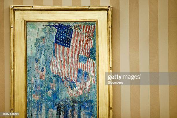 A painting of US flags sits on display in front of newly installed wallpaper in the Oval Office at the White House in Washington DC US on Tuesday Aug...
