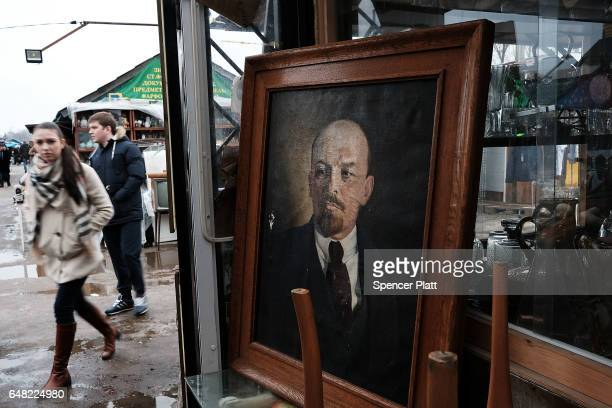 A painting of Vladimir Lenin the founder of the Russian Communist Party and the leader of the Bolshevik Revolution stands for sale at an outdoor flea...